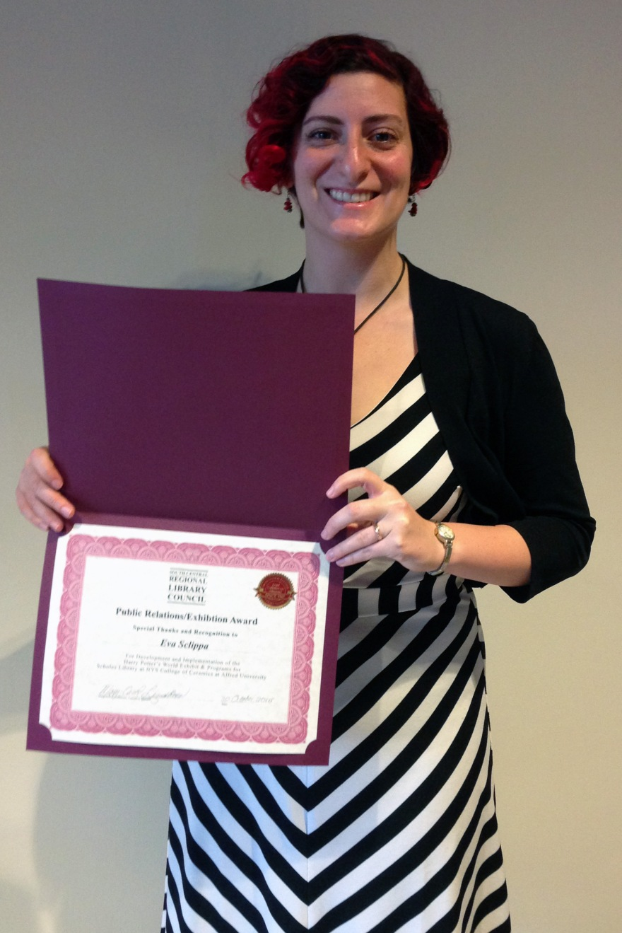Eva Sclippa with her award from the SCRLC
